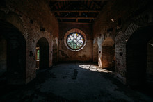 Round Stained Glass Window In Old Abandoned Castle