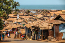 Flimsy Shacks With Corrugated Tin Roofs Make Up A Township Near The Coast Of Freetown, Sierra Leone, West Africa.