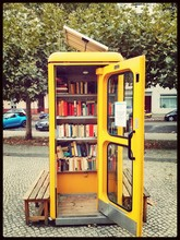 Old Phone Booth With Books
