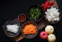 High Angle View Of Chopped Vegetables And Apples On Table