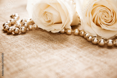 Fotografie, Obraz Close-up Of Pearl Necklace With Roses On Table