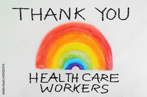 Fototapeta THANK YOU Healthcare workers rainbow drawing sign as appreciation support message for doctors and nurses fighting COVID-19 at hospitals. Coronavirus appreciation. obraz