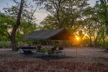 Sunrise On A Safari Camp In Th...