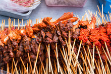 Close-up Of Food In Skewers For Sale At Market Stall