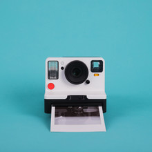 Close-up Of Instant Camera Against Blue Background