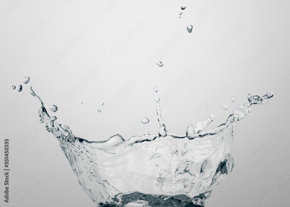 Fototapeta Macro shot of water splash with reflection