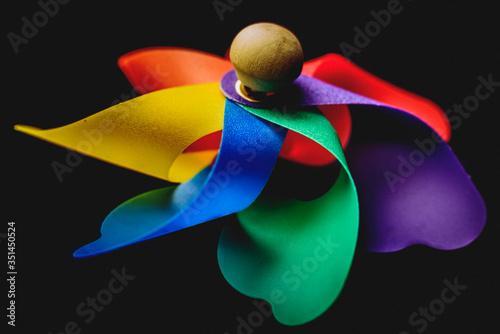 Fototapeta Close-up Of Pinwheel Toy Against Black Background