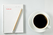 Directly Above Shot Of Coffee Cup And Notepad