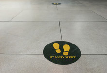 Stand Here Foot Sign Or Symbol On The Floor