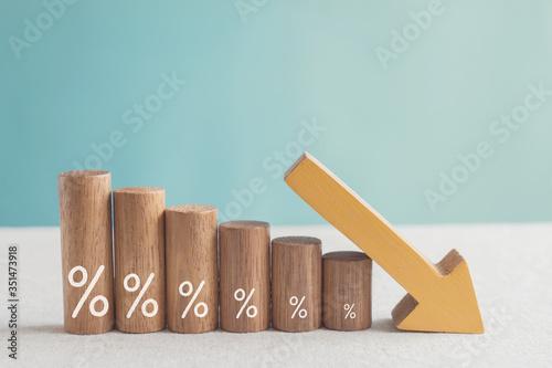 Obraz na płótnie Wooden blocks with percentage sign and down arrow, financial recession crisis, i