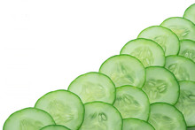 Close-up Of Cucumber Slices Over White Background