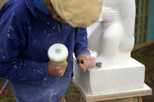 Sculptor Chiseling Stone