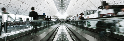 Fotografie, Obraz People on a moving walkway in a passenger terminal at the airport