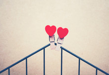 Close-up Of Heart Shape On Clothespin On Metal Against Wall