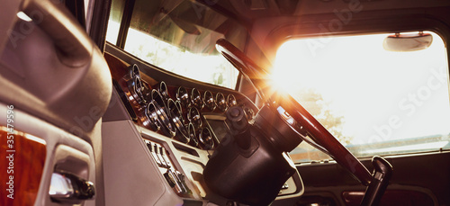 Valokuva Classic american commercial semi truck with stylish chrome gauges panel and custom luxury wooden steering wheel