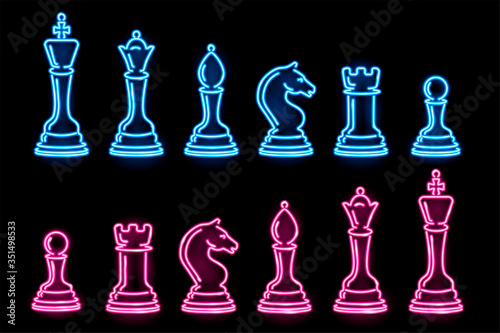 Photo Set of neon chess pieces isolated on black background
