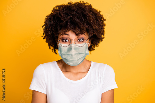 Obraz Close-up portrait of her she nice cute lovely pretty attractive wavy-haired lady save covid-19 infection wearing medical mask white t-shirt isolated over bright vivid shine background - fototapety do salonu