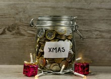 Close-up Of Coins In Jar At Table During Christmas