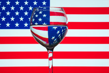 Close-up Of Drink In Glass Against American Flag