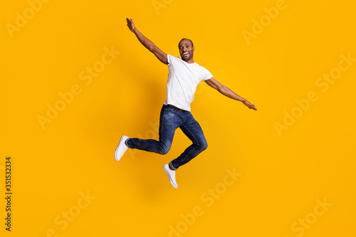Full length body size view of his he nice attractive cheerful cherry guy jumping having fun weekend vacation free time isolated over bright vivid shine vibrant yellow color background #351532334