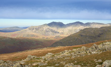 Summit Views Of Sca Fell, Scafell Pike, Great End And Little Stand From Great Carrs On A Sunny Day In The Lake District.