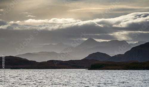 Obraz Distant views of cloud over the Torridon mountains from Loch Kernsary near Poolewe in the Scottish Highlands, Scotland, UK. - fototapety do salonu