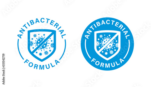 Photo Antibacterial formula stamp, shield with crossed bacteries inside