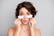 Portrait of dreamy charming lovely girl put patches under eye enjoy her new anti aging rejuvenation mask send air kiss isolated over gray color background