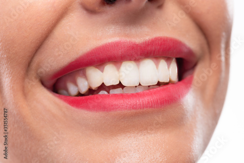 Close up of pretty lips, beautiful smile and healthy teeth #351554787