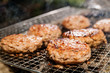 canvas print picture Close-up Of Pork Burger Patties On Barbecue Grill