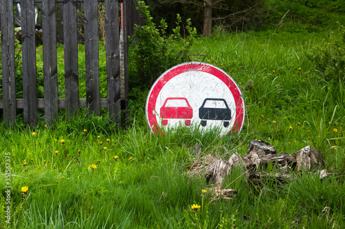road sign, no overtaking prohibited, lies in the grass, concept the absorption b Canvas Print