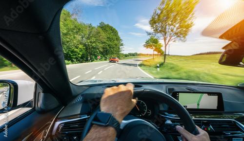 Fototapeta hands of car driver on steering wheel, road trip, driving on highway road obraz