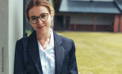 Female high school student in uniform looking at camera Fototapet