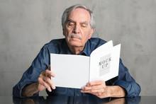 Senior Man Reading A Book Mockup