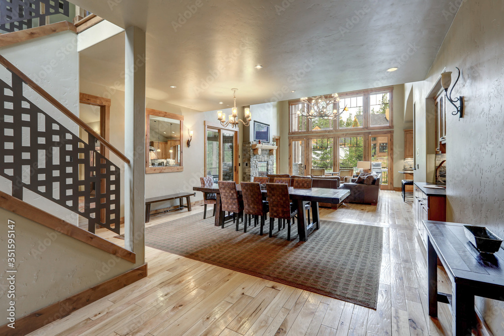 Fototapeta Amazing grand new luxury home with soft natural wall color and light hardwood floor