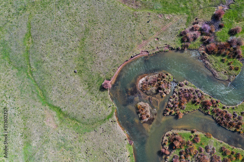 A 4k High resolution aerial view of a western trout stream in Wyoming. - 351602327