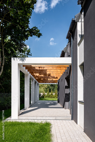 Elegant home veranda with wooden ceiling Fotobehang