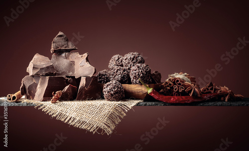 Obraz Chocolate truffles with broken pieces of chocolate and spices. - fototapety do salonu