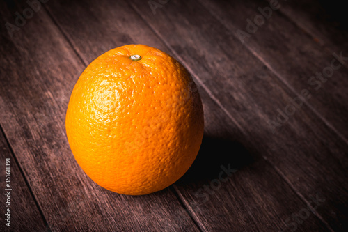 Close-up Of Orange Fruit On Wooden Table