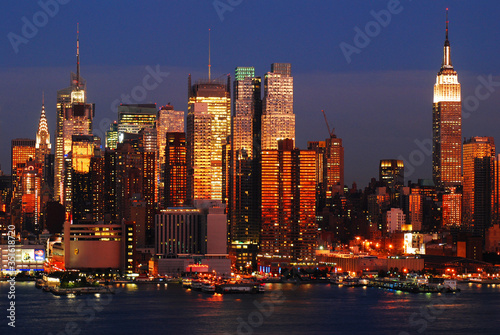 Fototapety, obrazy: The sunset colors are reflected in the glass skyscrapers of Manhattan