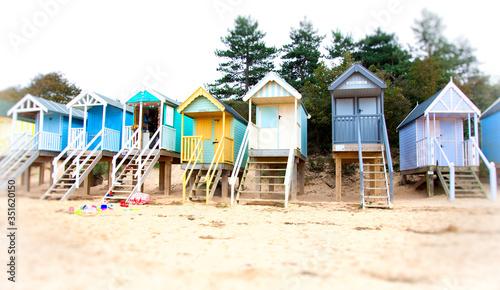 Fototapeta colorful wooden houses on the beach obraz