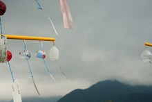 Low Angle View Of Wind Chimes Hanging Against Sky