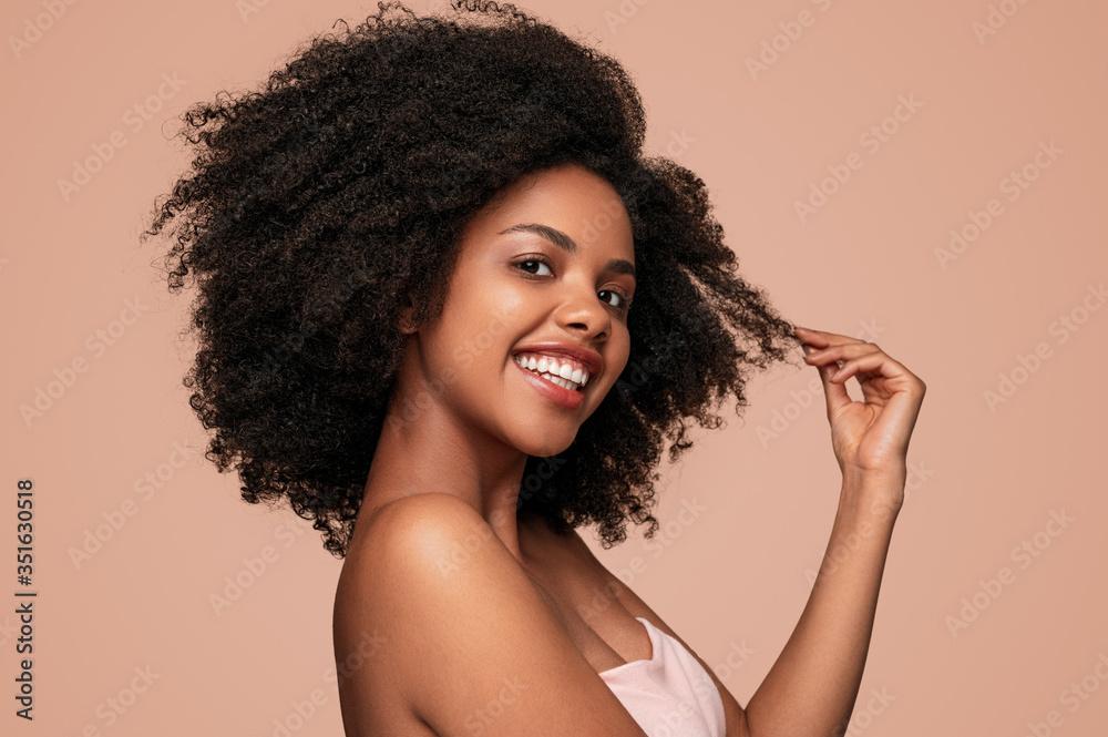 Fototapeta Happy black woman touching clean hair