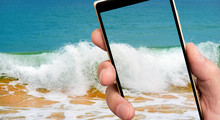 Surf Waves On Smartphone Screen. Clear Sea Water. Stormy Sea.