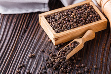 Aromatic Black Pepper On A Dark Wooden Rustic Background
