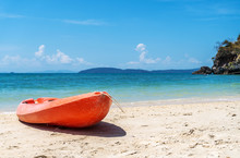 Red Orange Kayak On Sand Beach...