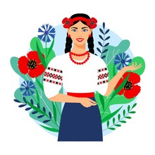 Ukrainian Girl In Traditional Clothes On A Background Of Leaves And Flowers. Beautiful Woman In An Embroidered Shirt