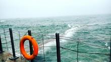 Life Belt By Sea On Railing