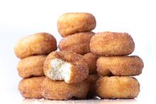 Cinnamon Sugar Mini Donuts In A Stack On White Background