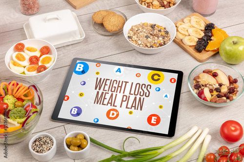 Obraz Healthy Tablet Pc compostion with WEIGHT LOSS MEAL PLAN inscription, weight loss concept - fototapety do salonu
